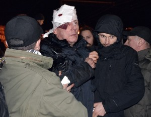 Lutsenko receives medical help after clashes with riot police near a court in Kiev