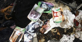 A picture of 18-month-old Palestinian baby Ali Dawabsheh, who was killed after his family's house was set to fire in a suspected attack by Jewish extremists, is seen at the burnt house in Duma village near the West Bank city of Nablus