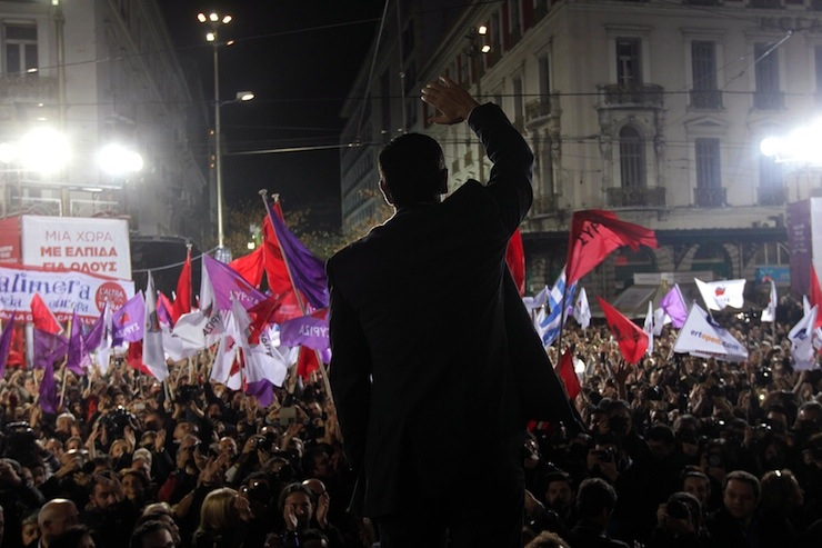 Alexis Tsipras, opposition leader and head of radical leftist Syriza party, waves to supporters during an election rally in Athens